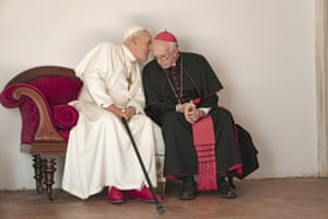 Jonathan Pryce (right) as Cardinal Bergoglio, right, and Anthony Hopkins as Pope Benedict in The Two Popes.