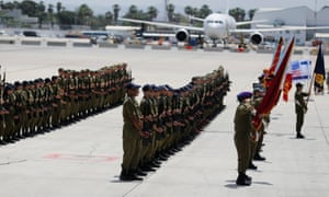Israeli soldiers take part in a dress rehearsal of the ceremony that will welcome Donald Trump upon his arrival at Ben Gurion International airport.