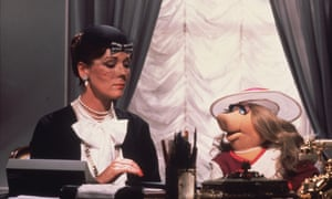 Lady Holiday, played by Diana Rigg, gives instructions to her secretary, Miss Piggy, in Jim Henson's The Great Muppet Caper, 1981