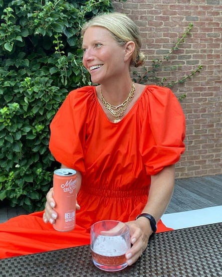 Gwyneth Paltrow at home in a ketchup-red sundress.