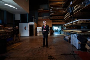 Theresa May addresses the media at the end of her tour of the Octink sign manufacturing factory in Brentford, west London.