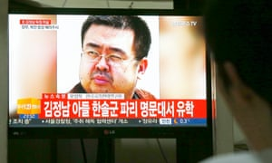 A man watches a news report in South Korea about the death of Kim Jong-nam