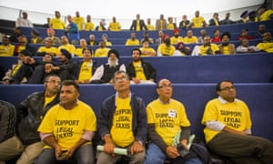 Taxi drivers and anti-Uber protesters at Toronto city hall