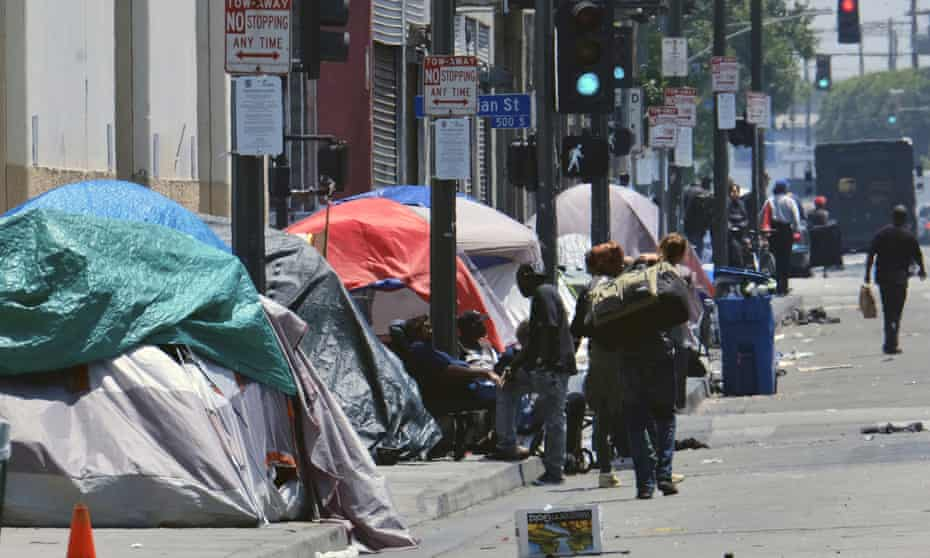 Tents housing homeless people line a street in downtown Los Angeles.
