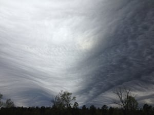 Asperitas is characterized by wave-like structures in the underside of the cloud. Here undulatus is developing into asperitas in Cope, US