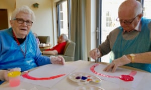 Residents paint rainbow pictures