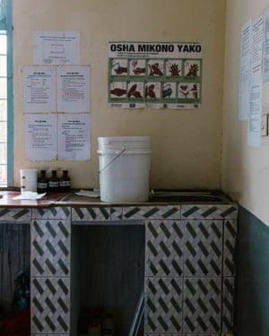 A hand washing bucket over a non-functional basin at Nyarugusu Dispensary