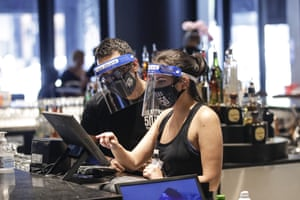 Bartenders wearing masks and face shields at Slater's 50|50 in Santa Clarita, California, yesterday