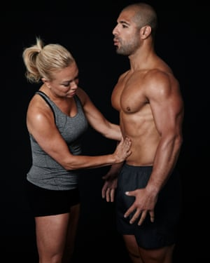 Belisa Vranich teaches a client to use his diaphragm to breathe.