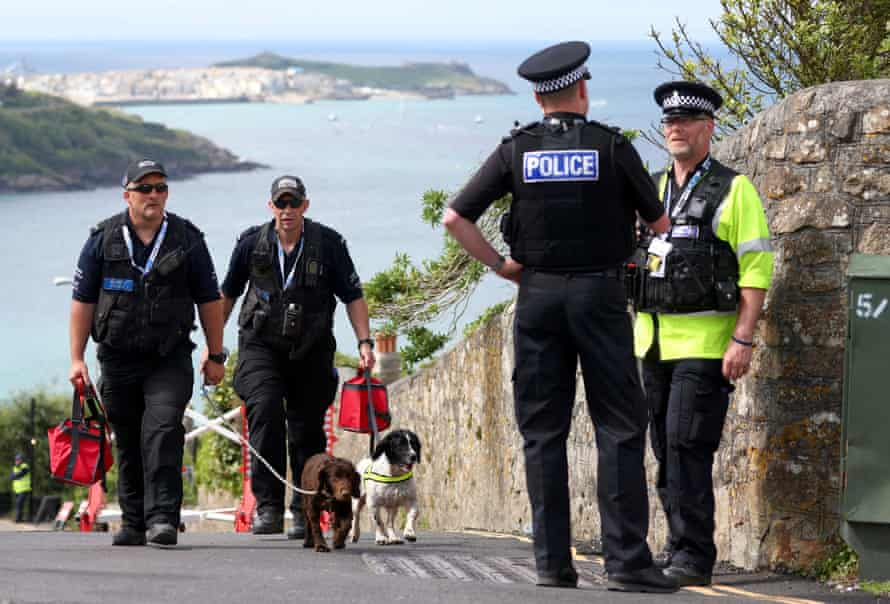 Police officers near the Carbis Bay Hotel