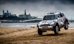 British driver Harry Hunt's Mini racing in the Silk Way rally