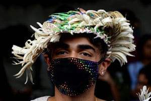 An Indian supporter of the lesbian, gay, bisexual, transgender (LGBT) community wearing a pollution masks takes part in a pride parade in New Delhi