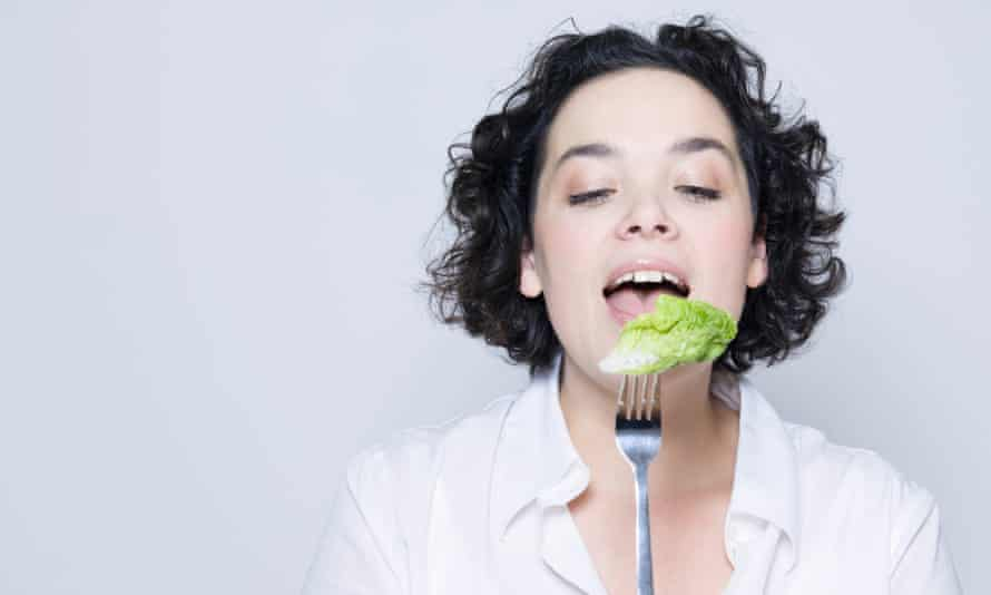 Woman eating salad