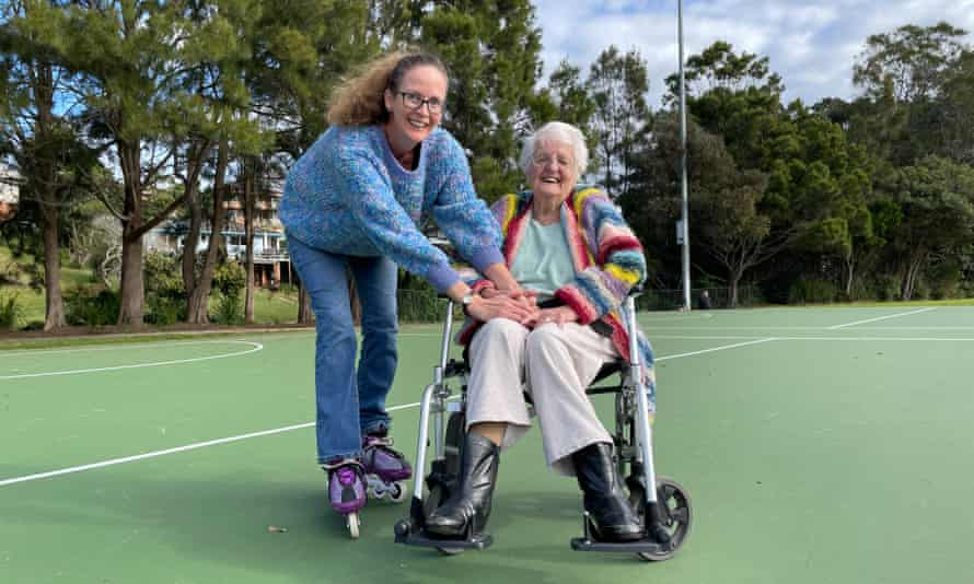 Anna Featherstone and her mother practicing roller skating at the local netball court.