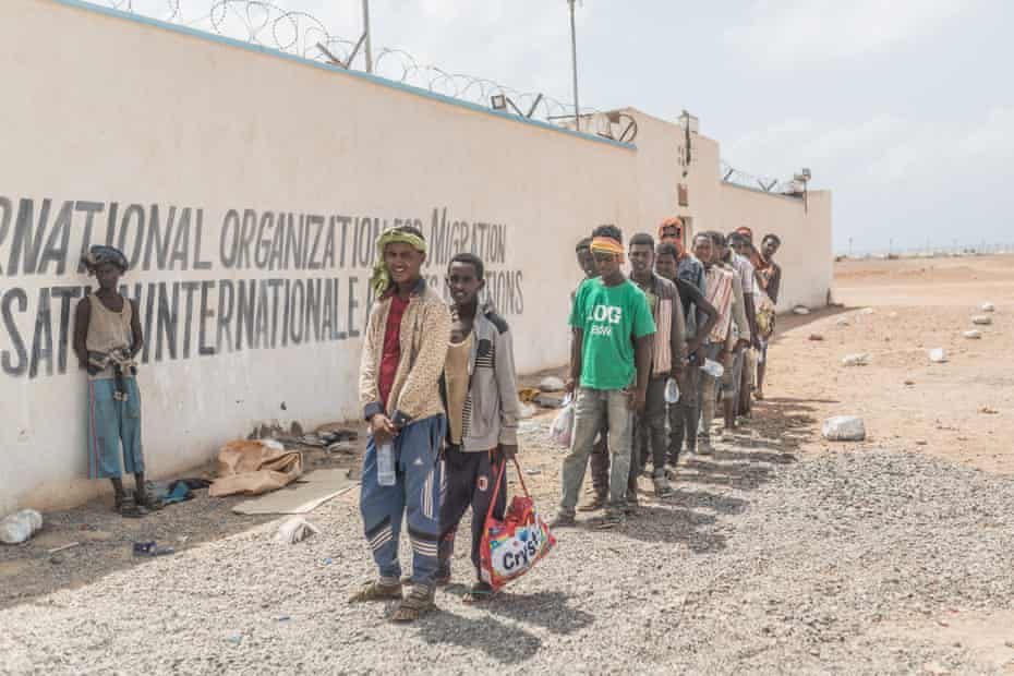 People queue to register at the IOM transit centre in Obock, where voluntary returns to Ethiopia are organised