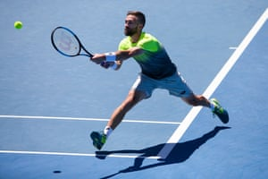 A player on the outer courts hits a backhand return.