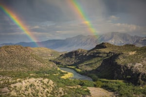 A double rainbow over Big Bend National Park, Texas, with the Rio Grande marking the US-Mexico border, with Mexico on the right. A new documentary, The River and The Wall, examines the diverse wildlife and landscape along the border