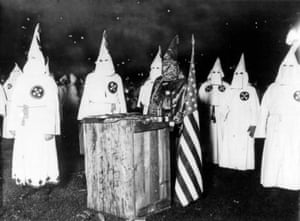 Nearly 30,000 Ku Klux Klan members meet at a night rally in Chicago, circa 1920.