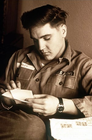 Elvis Presley is pictured in his Army fatigues in this undated handout photo. Presley, born in Tupelo, Mississippi in 1935 died at his Memphis home, Graceland, 16 August, 1977.