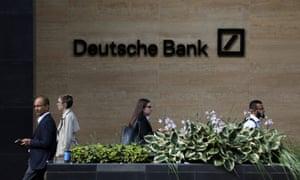 People walk past a Deutsche Bank office in London, Britain July 8, 2019. REUTERS/Simon Dawson