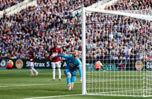 Manchester United's David de Gea looks on as West Ham's Andriy Yarmolenko scores their second goal.