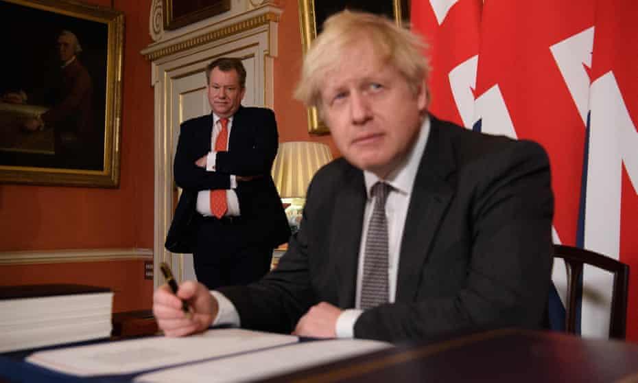 Negotiator David Frost looking on as Boris Johnson signed the UK-EU trade deal in December 2020.