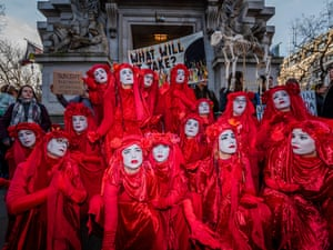 Extinction Rebellion's Red Rebels block the entrance to the Australian high commission in London. XR activists hold the Australian government and its environmental policy responsible for the massive bushfires ravaging the country since September 2019
