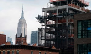 A building under construction is seen in front of the Empire State Building in New York.