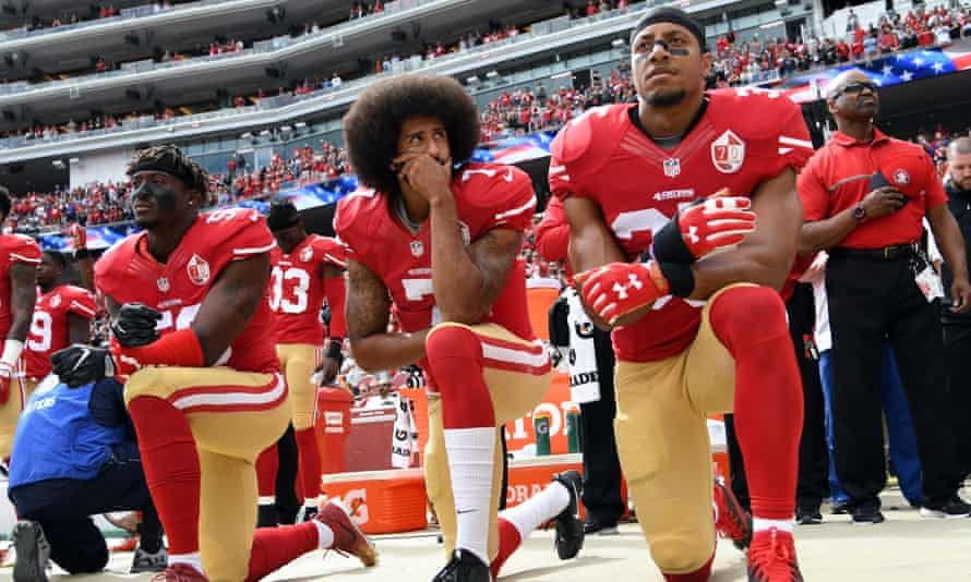 From left: Eli Harold, Colin Kaepernick and Eric Reid kneel during the national anthem