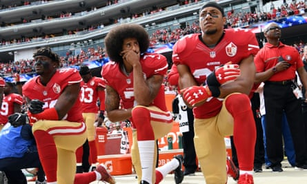 The San Francisco 49ers 'take the knee' during the national anthem, as a statement against racial injustice