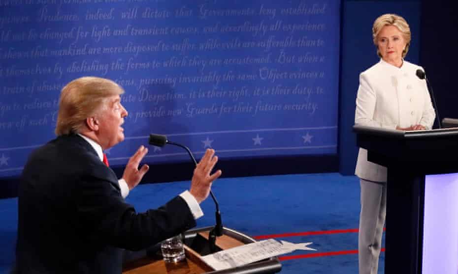 Donald Trump gestures as Democratic nominee Hillary Clinton looks on during the final presidential debate in Las Vegas, October 2016.