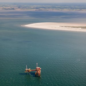 NAM gas drilling rig near mud flats in the Wadden Sea Islands.