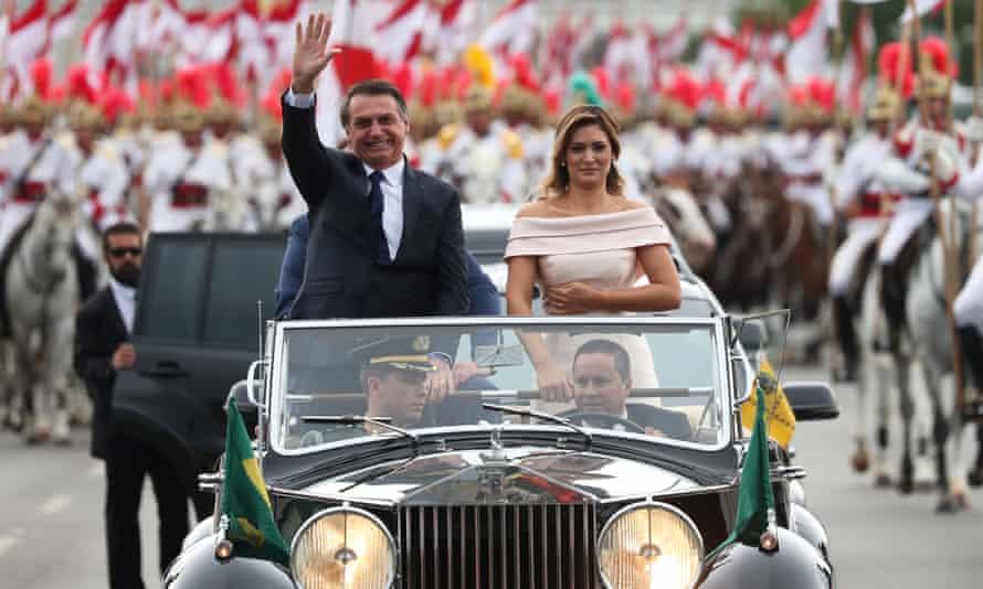 Jair Bolsonaro waves before his swearing-in ceremony in Brasília, Brazil on 1 January.