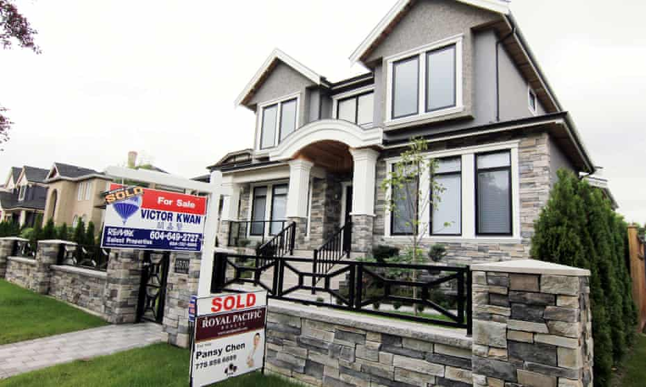 Realtors' signs are hung outside a newly sold property in a Vancouver.