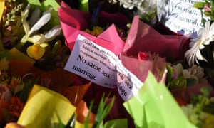 An anti marriage equality message to then prime minister Tony Abbott from a Christian lobbyist is seen among a floral arrangement in front of Parliament House in Canberra in August 2015.