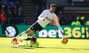Tottenham's Dele Alli takes a dive over Wayne Hennessey of Crystal Palace