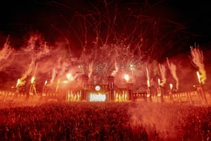 Nürburg, Germany: Techno fans dance during a firework display at the New Horizons music festival at the Nürburgring race track.