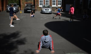Year 6 children playing outside while observing social distancing at a school in north London.