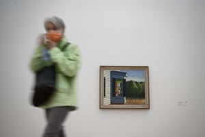 A visitor passes Edward Hopper's Cape Cod Morning at the Beyeler Foundation in Riehen near Basel, Switzerland. Hopper's locked up, lonely characters and empty spaces have gained currency during the pandemic