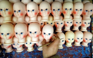 Krasnoyarsk, RussiaAn employee paints heads of Snegurochka (snow maiden), granddaugter of Father Frost, at the Biryusinka toy factory, which has been producing decorations and toys for the festive season since 1942