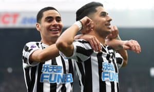 Miguel Almirón (left) celebrates Newcastle's second goal with scorer Ayoze Pérez.