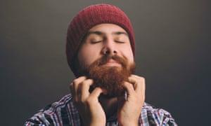 Enjoying Scratching his BeardYoung hipster Bearded man Scratching his Beard
