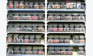 Cigarette packets with health warnings are displayed in a convenience store