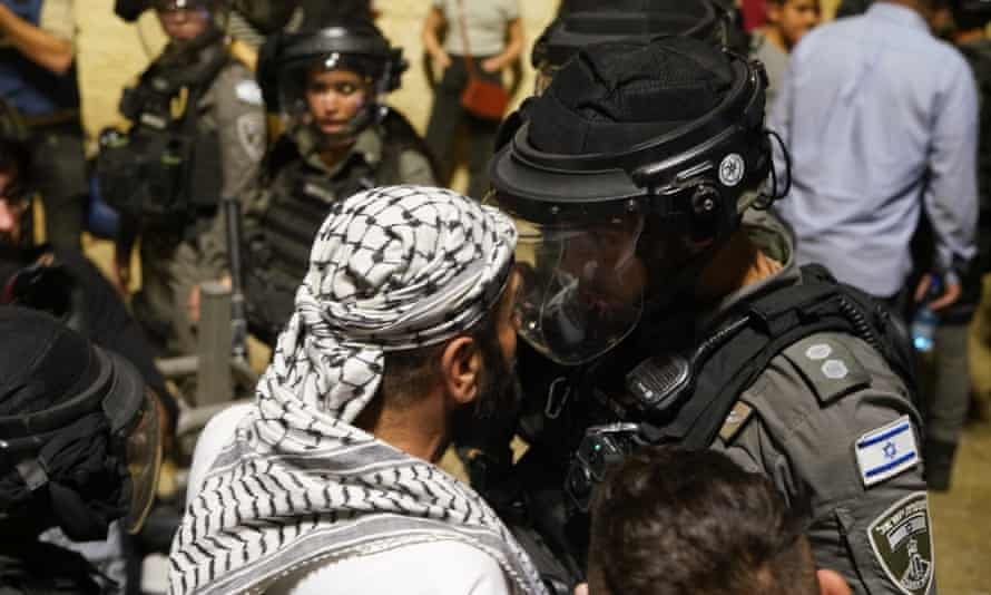 A face-off between a Palestinian and a member of the Israeli forces in East Jerusalem last week.
