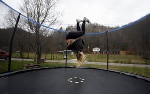 Madison Bentley, 14, does a somersault on the trampoline in front of her home in Virgie, Kentucky where she lives with her mother and brother following the death of her father earlier this year.
