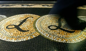 A mosaic incorporating pound symbols on the floor of the front hall of the Bank of England in London.