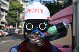 Yangon, Myanmar. A protester wears improvised tear gas protection gear during a demonstration against the military coup