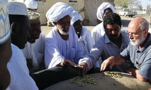 Ian Robinson, right, in Sudan in 2006. He liked to become directly involved at village level in offering farmers advice on seeds, storage, marketing and all the other challenges facing local agriculture