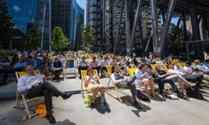 City of London workers enjoying last year's heatwave, which brought a mini economic boom.