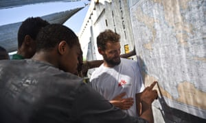 Rescued migrants show MSF staff their departure point.